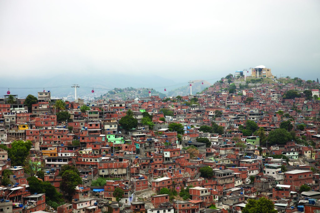 Complexo do Alemao is one of Rio's largest favelas. After pacification, there have been investments in new housing, and a new cable car transport system. UPP police stations are located at the cable car stops. Photograph by Tuca Viera for LSE Cities